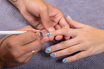 Manicure in beauty salon. Master make  nail design. Manicuring hands.