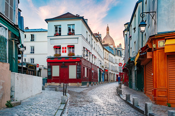 Empty street, cafe and the Sacre-Coeur in the morning, quarter Montmartre in Paris, France