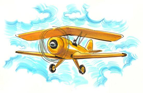 Yellow biplane in the sky