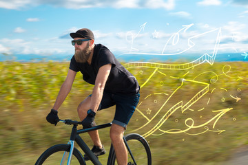 Young cyclist in casual clothing with fabulous nature background