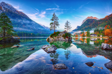 Fantastic autumn sunrise of Hintersee lake. Classic postcard view of Hintersee