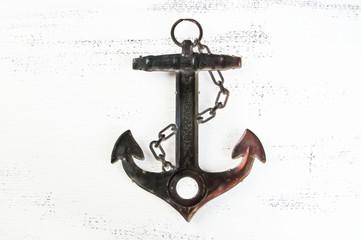 Vintage brass anchor wooden background
