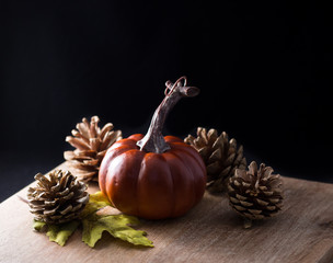 autumn still life with pumpkins and pine cones