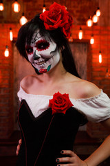 Image of halloween girl with white make-up on her face