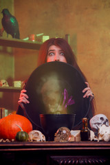 Photo of witch hiding behind black hat