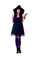 Full-length photo of surprised witch with wine glass with wine in black dress and hat
