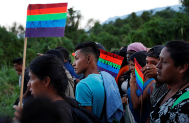 Migrants, part of a caravan traveling to the U.S., walk north from Huixtla, Mexico