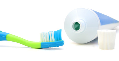 Tube of toothpaste and toothbrush. Isolated on a white.