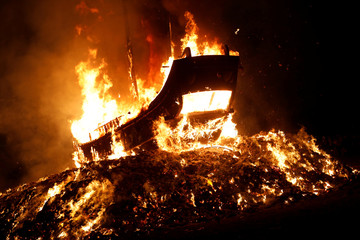 'Wang Yeh's Boat', a 13-meter finely crafted ancient warship made of paper and wood sets on fire to ward off evil, disease and bad luck during Wang Yeh Boat Burning Festival, in Pingtung