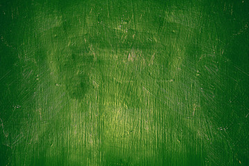 Vintage wall-background and texture with large details. Green wall in paint.