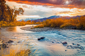 Fall dusk along the Provo River, Utah, USA. Wall mural