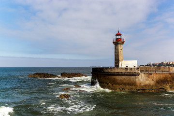 Lighthouse in Foz do Douro at the mouth of the river Douro in Porto, Portugal. Atlantic ocean.