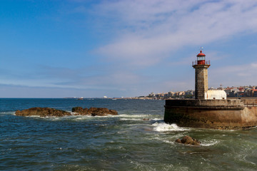Lighthouse in Foz do Douro at the mouth of the river Douro in Porto, Portugal. Atlantic ocean. Travel photography.