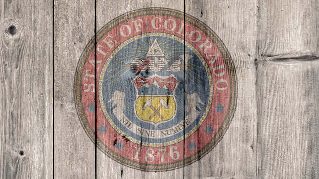 USA Politics News Concept: US State Colorado Seal Wooden Fence Background