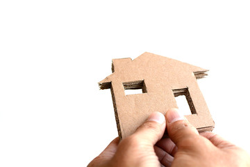 holding a cardboard house isolated on white background, crisis concept, homeless.