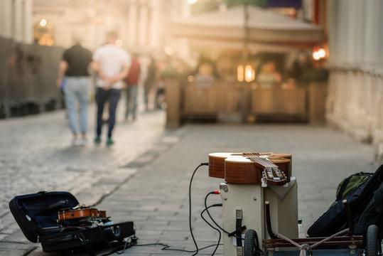 Closeup of guitar and equipment of street musician during break