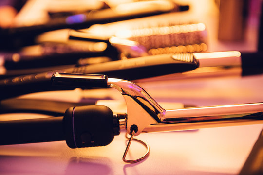 Hairstyle hot electric tools on hairstylist table ready to use