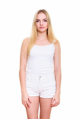 Studio shot of young beautiful teenage girl standing