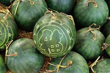 Watermelons with festive engraving on Eve of Vietnamese New Year. Hue, Vietnam.