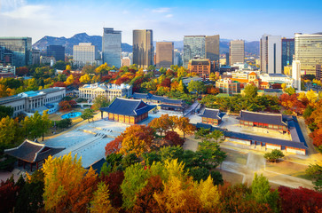 Autumn park and temple in old palace in Seoul city