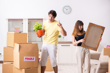 Young pair moving to new flat with fragile things