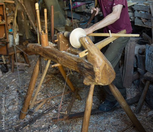 Hand carving a wooden bowl with a foot powered wood lathe, no