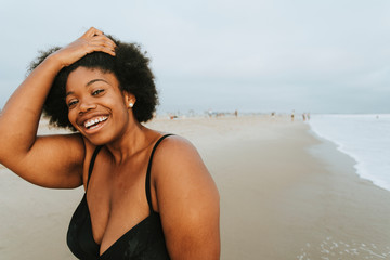 Beautiful plus size African American woman at the beach