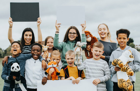 Group of kids caring about animal rights