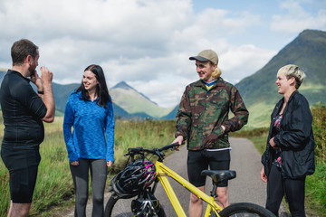 Cyclists in Glen Etive, Scotland