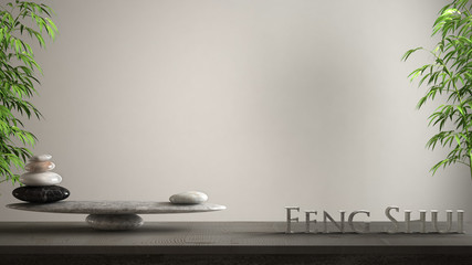 Empty interior design concept zen idea, wooden vintage table or shelf with marble stone balance and 3d letters making the word feng shui over blank white background copy space
