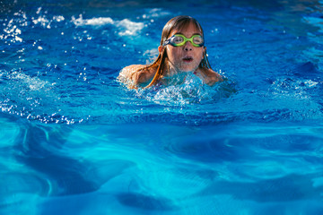 Young swimmer girl in swimming pool