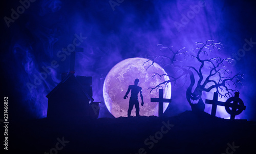 Scary view of zombies at cemetery dead tree, moon, church and spooky