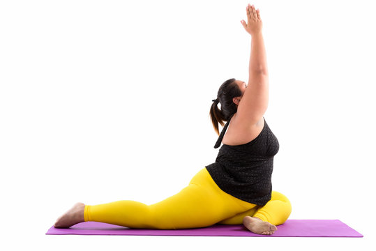 Studio shot of young fat Asian woman stretching her legs and rea