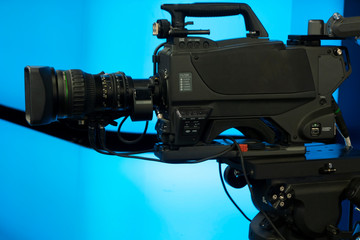 Close-up of a Television Camera in a blue screen studio environment.
