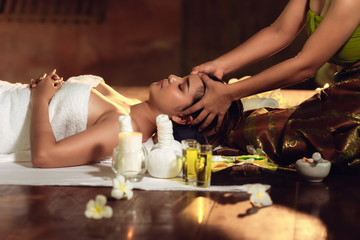 Portrait of Asian woman is relaxing in spa massage, Thai massage