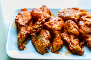 chicken wings marinated in a barbecue sauce, a typical American snack