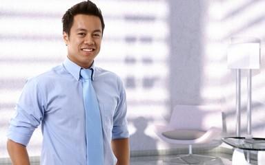 Portrait of happy young asian businessman