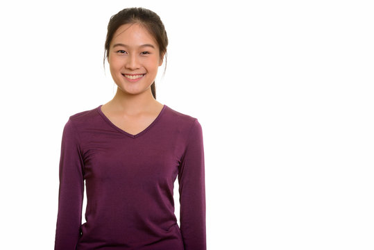 Portrait of young happy Asian teenage girl smiling