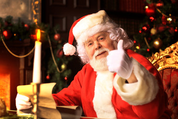 Santa Claus standing with thumbs up. Home decoration.