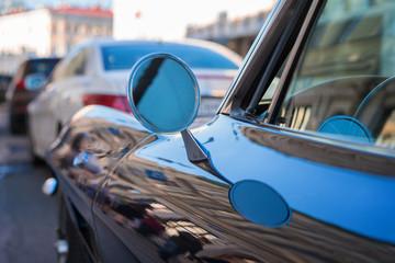 retro car fragment. side mirror of a vintage car, vintage mirror of a car, round shape side mirror