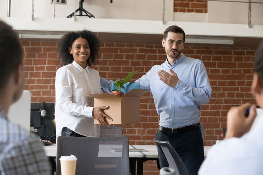 Friendly company ceo welcoming female african american employee introducing hired worker in multiracial office getting acquainted supporting new team member on first work day, introduction concept