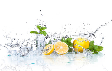 ice cubes and splashing water with mint and lemon on a white background