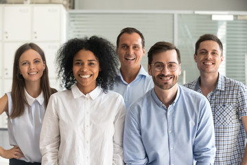 Smiling diverse office workers group, happy multiracial professional members employees looking at camera, motivated staff business people posing together, multi-ethnic workforce sales team portrait Wall mural