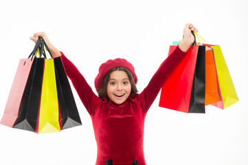 Shopping happiness. Girl child enjoy shopping. Little shopper. Small girl with shopping bags. Small child with paper bags. Little shopaholic with paperbags. Shopping is an addiction