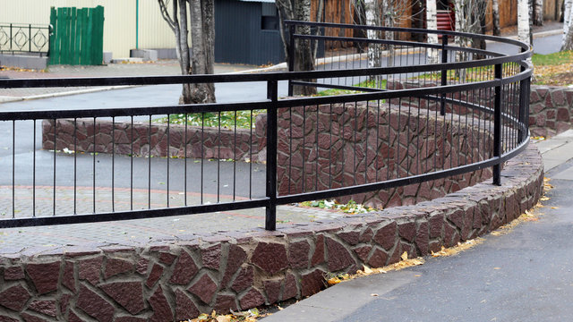 Beautiful low metal fence in the Park