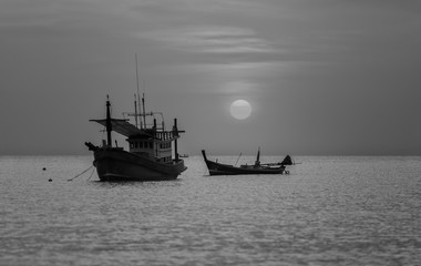 Fishing boat at the sae during sunset in black and white, Phuket Thailand.