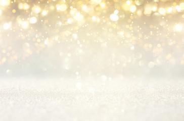glitter vintage lights background. silver and gold. de-focused.