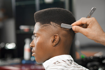 Side view of man with stylish haircut in barber shop