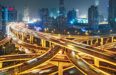 Scenic view on large highway interchange in Shanghai, China at night. Scenic skyline.