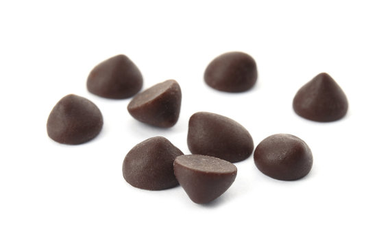 Pile of delicious dark chocolate chips on white background